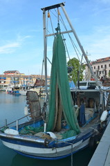 Boat lying in the harbour of Grado, Italy at Adriatic Sea