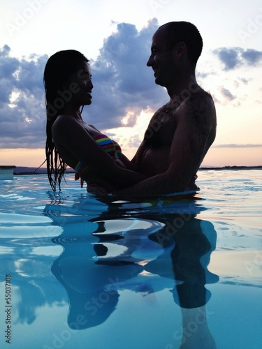 couple at dusk in water