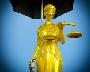 Lady of Justice is waiting to kill