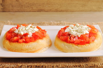 Dakos, Cretan recipe with bread, tomato, feta and oregano