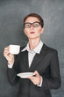 Serious teacher with cup of coffee
