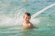 boy having fun in water