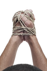 man with his hands tied with rope