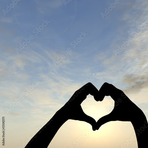 Conceptual heart shape sunset silhouette