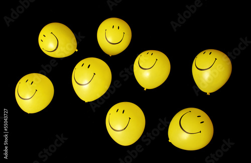 Isolated smiley face balloons
