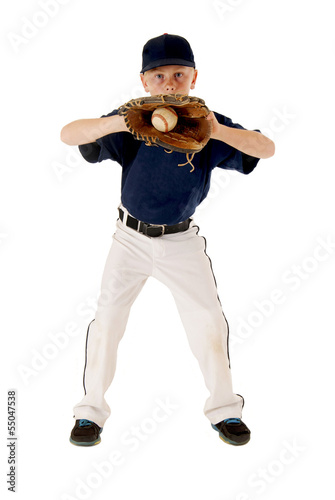 Young baseball player catching ball
