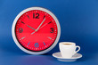 Cup coffee and clock on blue background