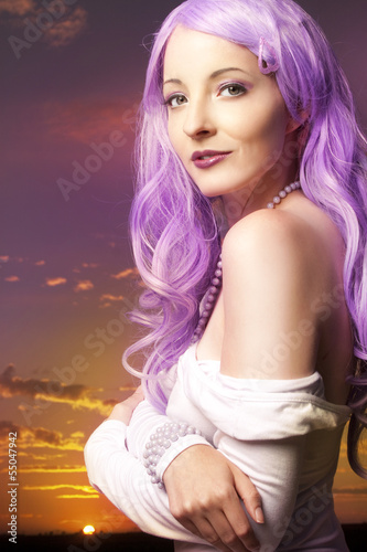 Beautiful woman in front of cloud background
