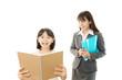 笑顔の女の子と女性教師