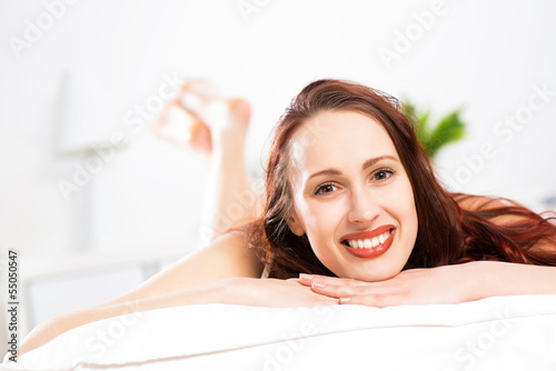 portrait of a young woman in the bedroom