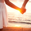 Love - romantic couple holding hands, beach sunset