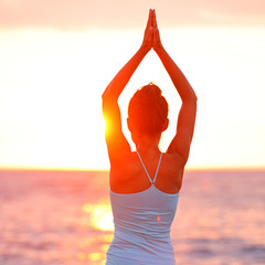 Meditation Yoga woman meditating at beach sunset