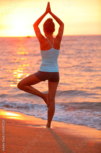 Yoga meditation woman meditating at beach sunset