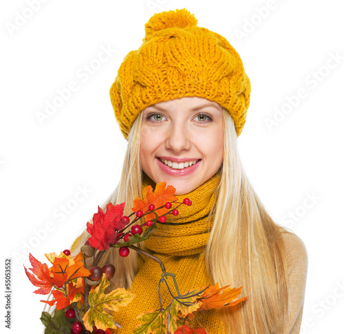 Smiling young woman holding autumn bouquet