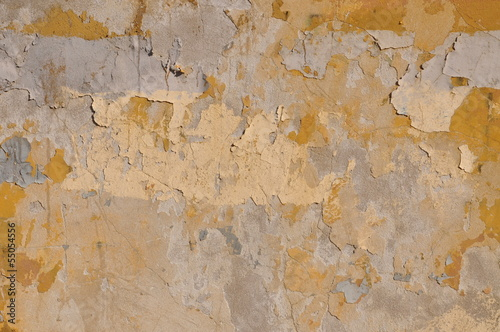 Old wall with peeling yellow paint
