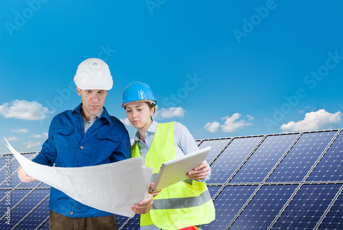 engineers installing solar panels