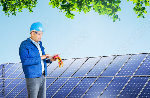 engineer installing solar panels