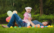 Happy mom and baby are playing in the park