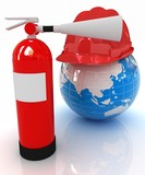 Red fire extinguisher and hardhat on earth
