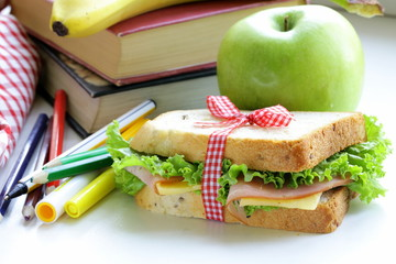 sandwich with ham, apple, banana and granola bar - school lunch