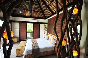 Interior of luxury tropical villa / bedroom