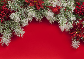 Christmas decorations over red satin