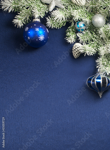 Christmas decorations over  blue  satin
