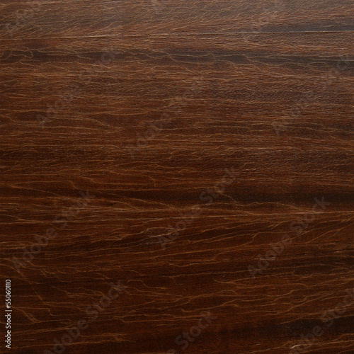 Brown varnished wood fragment