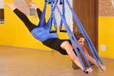 Woman doing anti gravity Aerial yoga exercise