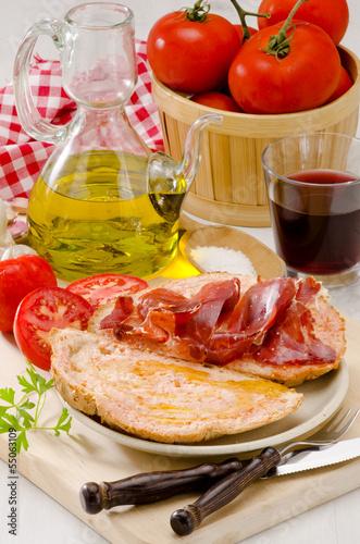 Spanish Cuisine. Tomato bread and Serrano Ham. Pa amb tomaquet i