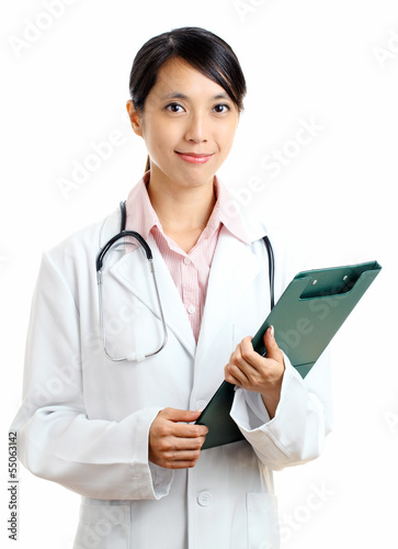 Asian female doctor with writing pad