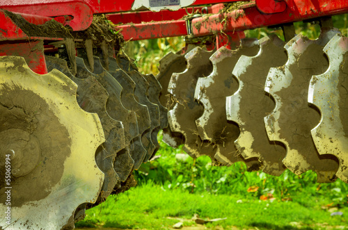 Disk harrow sitting in Green plantation