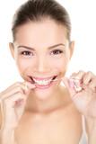 Fototapety Woman flossing teeth smiling using dental flush