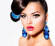 Fashion Model Girl Portrait with Brown Eyes and Blue Earrings