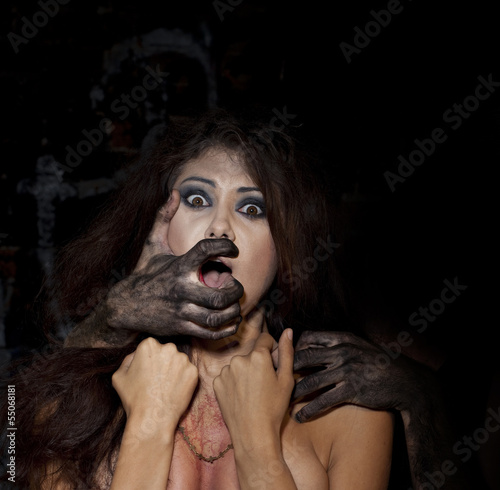 Frightened girl with dirty arms