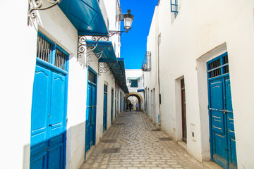 Tunis streets with traditional white and black painted buildings