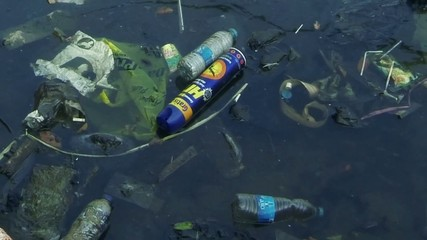 Dirty plastic bottle rubbish in water