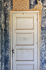 shut door in abandoned house