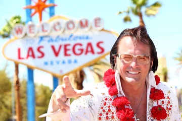 Elvis impersonator man in front of Las Vegas sign