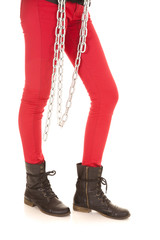 woman legs in red pants chain