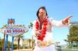 Leinwanddruck Bild - Elvis look-alike impersonator and Las Vegas sign