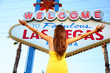 Welcome to Fabulous Las Vegas sign woman happy