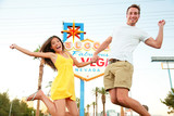Las Vegas Sign - Happy couple jumping