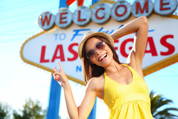 Tourist woman in Las Vegas sign posing happy