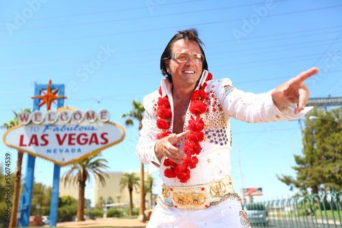 Leinwanddruck Bild Elvis look-alike impersonator and Las Vegas sign