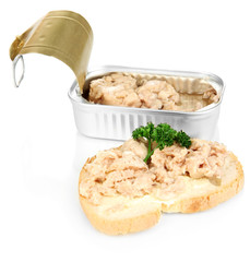 Open tin can and tasty sandwich with cod liver, isolated