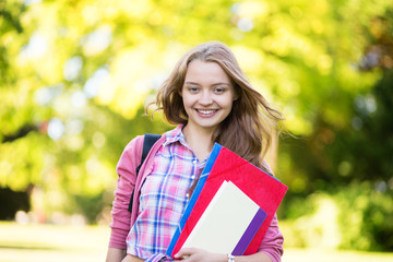 Student girl going back to school and smiling