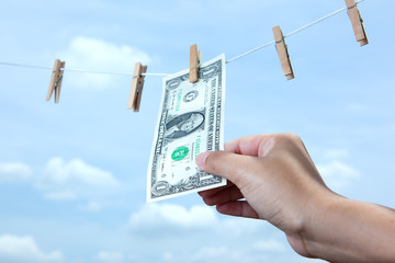 hand pull money from clothes line