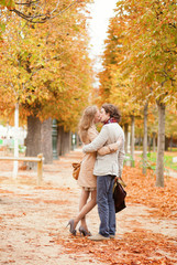Dating couple in Paris on a fall day