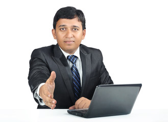 Cheerful Young Indian business man with Laptop